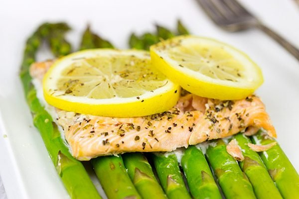 Baked all together in a foil packet, this Herbed Lemon Salmon is an easy (and healthy!) weeknight dinner idea.