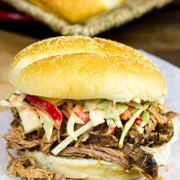 Now that the weather is turning cooler, dust off the slow cooker and whip up some of these Slow Cooker Cajun Pulled Pork Sandwiches!