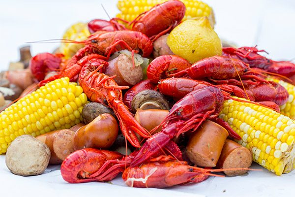 Head to the backyard this weekend and host a Cajun Crawfish Boil with friends!