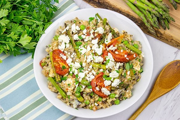Looking for a healthy summer salad? Try roasting the tomatoes and asparagus! This Farro and Wild Rice Salad is quite tasty!