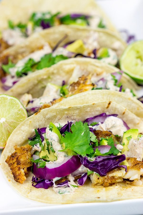 These Grilled Fish Tacos are packed with flavor...perfect for a summer dinner on the back porch!