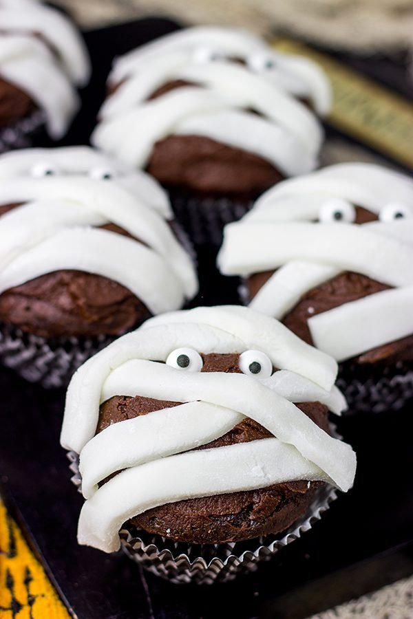 Who's watching you? Is it ghosts and goblins? If you're lucky, it's these Chocolate Mummy Cupcakes!