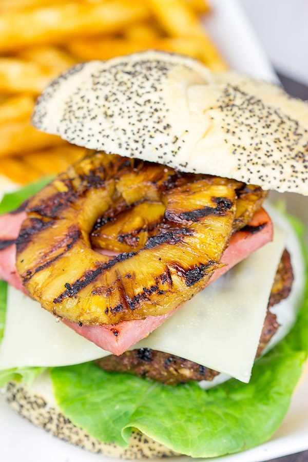 Piled high with teriyaki pineapples and grilled ham, this Grilled Aloha Burger deserves a spot on your dinner menu!
