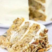 This classic Southern Hummingbird Cake is filled with pecans, bananas and pineapples and topped with a tasty cream cheese frosting!