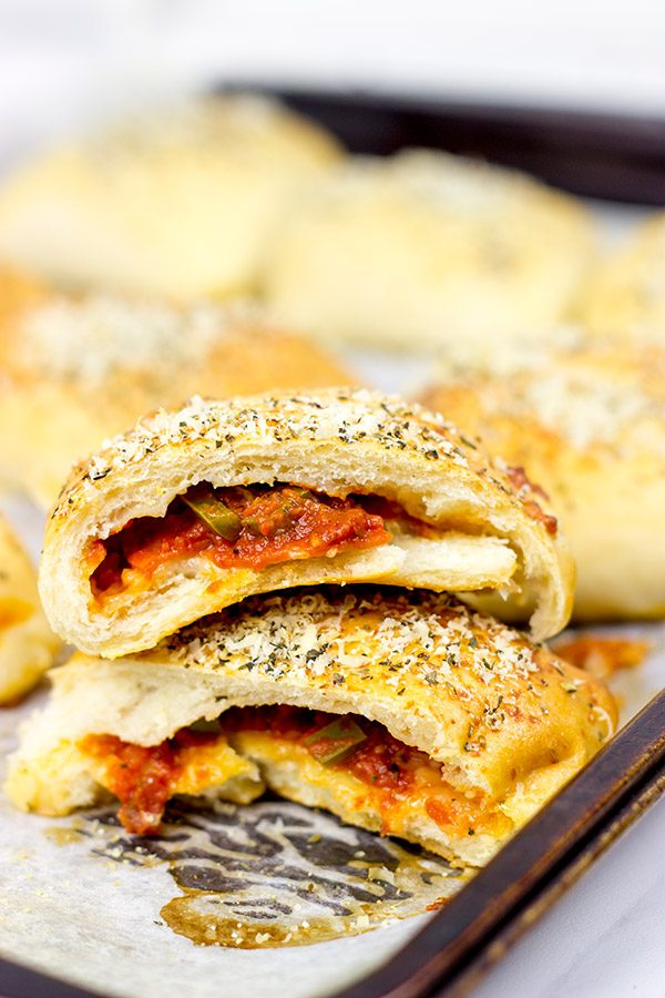 Who says pizza needs to be served by the slice? These Stuffed Pepperoni Pizza Rolls are a tasty twist on a classic!