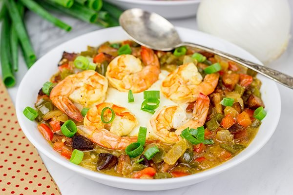 These Charleston Shrimp and Grits feature a bed of creamy grits topped with flavorful shrimp and Andouille sausage!
