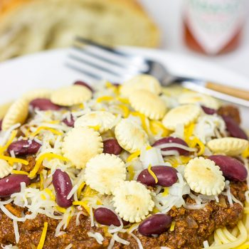 Chili served over spaghetti? Yup, it's the Cincinnati way! Whip up a batch of this Slow Cooker Cincinnati Chili for dinner tonight!