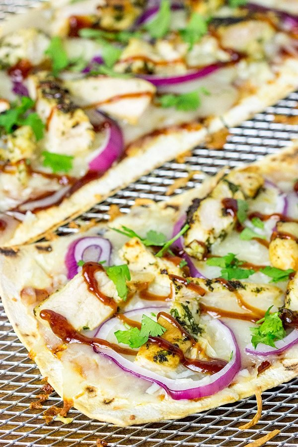 Want to surprise your family with a delicious dinner? Try whipping up a batch of these BBQ Chicken Flatbread Pizzas!