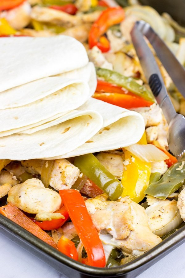 These Sheet Pan Chicken Fajitas are an easy and flavorful dinner...and clean-up is a breeze! This one is perfect for dinner on a busy weeknight!