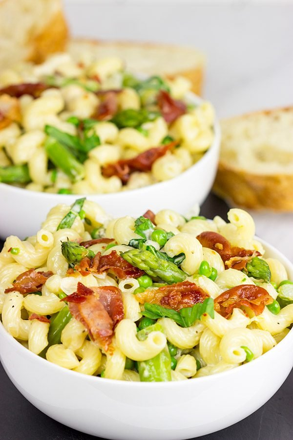 This Creamy Pasta Alfredo is served with asparagus and peas...and topped with crispy prosciutto!