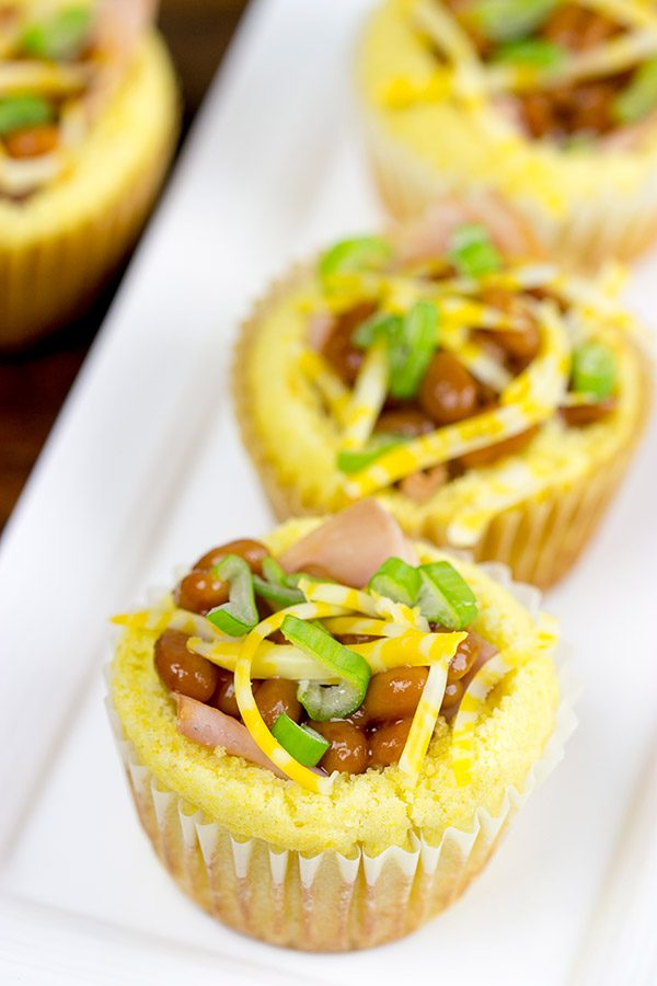 Think beyond the sandwich...by using cornbread bowls! These Ham and Baked Beans in Cornbread Bowls are a fun twist on a classic!