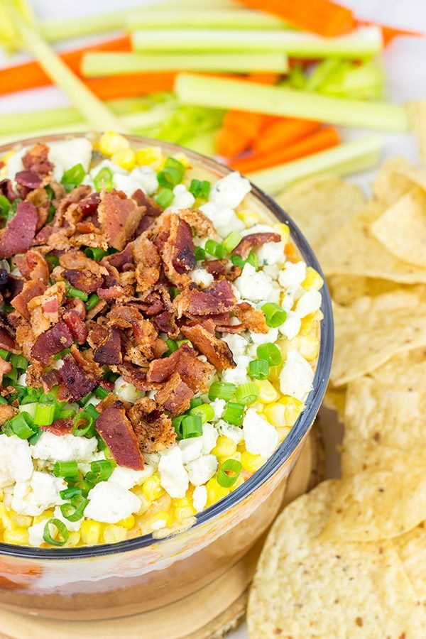 Complete with spicy buffalo chicken, creamy refried beans and crunchy bacon, this 7-Layer Buffalo Chicken Dip is a surefire party favorite!