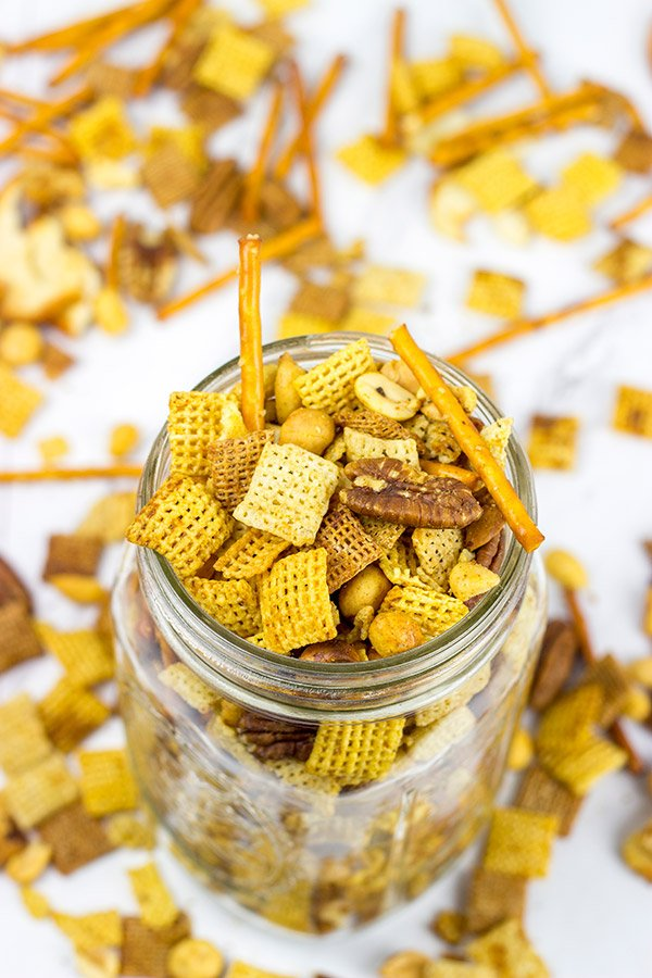 Craving a good snack for this weekend? This Slow Cooker Cajun Snack Mix is an easy and tasty treat!