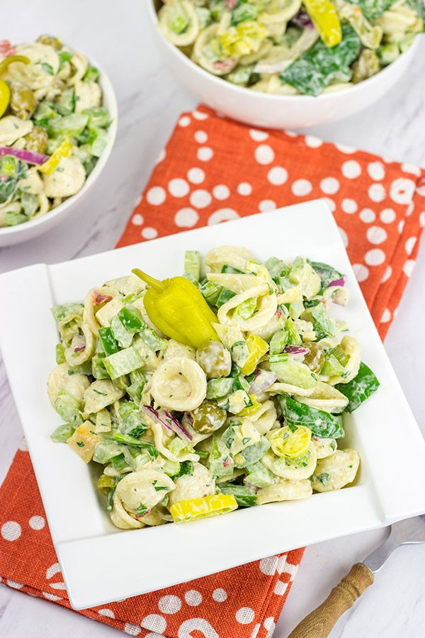This Smoked Mozzarella Pasta Salad has a secret ingredient: pepperoncini! This recipe is a delicious way to celebrate summer picnic season!