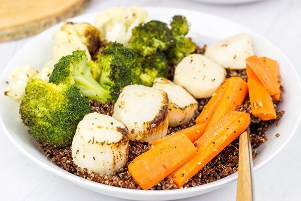 This Scallops and Roasted Veggies Quinoa Bowl is packed with flavor...and it can be made on a weeknight!