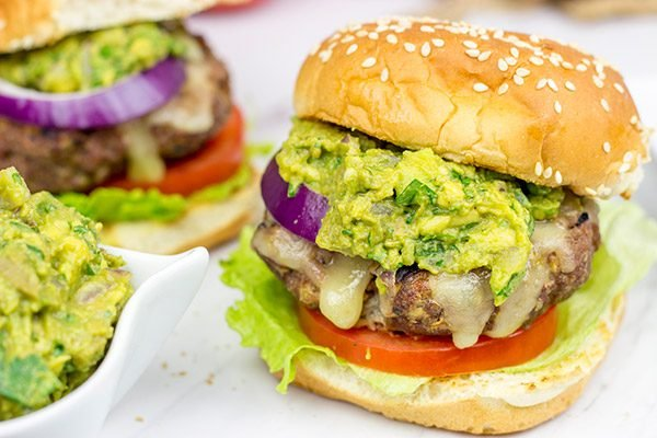 Have you ever tried guacamole on a burger? It's delicious! These Grilled Guacamole Burgers are a summer backyard favorite!