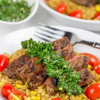 Looking for a delicious summer meal? This Grilled Flank Steak with Porcini Mushroom Pilaf will make you look like a superstar chef!