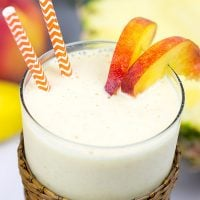 This Pineapple Peach Oatmeal Smoothie includes toasted oats for an extra layer of flavor. It's perfect for warm summer days!