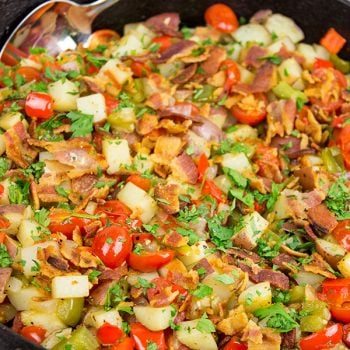 Pull out that cast iron skillet and whip up a batch of these Skillet Potatoes with Bacon and Cherry Tomatoes!