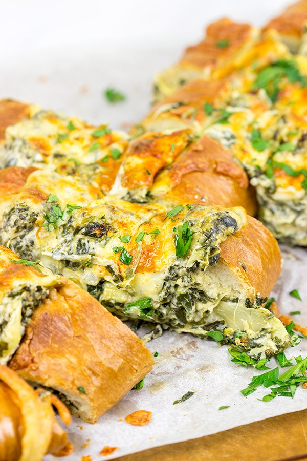 This Spinach Artichoke Stuffed French Bread is a tasty appetizer to serve while watching your favorite sport on tv!