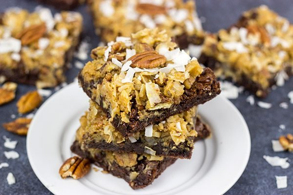 These German Chocolate Brownies feature a chewy, chocolate base topped with toasted almonds and coconut!