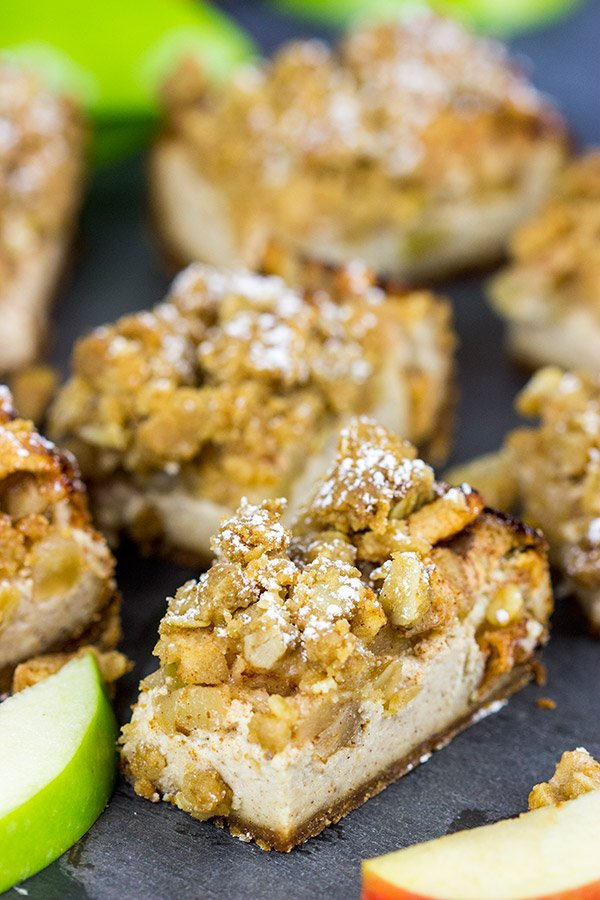 Apple cobbler or cheesecake for dessert? Why not both! These Apple Cobbler Cheesecake Bars are a tasty way to end a chilly Autumn day!
