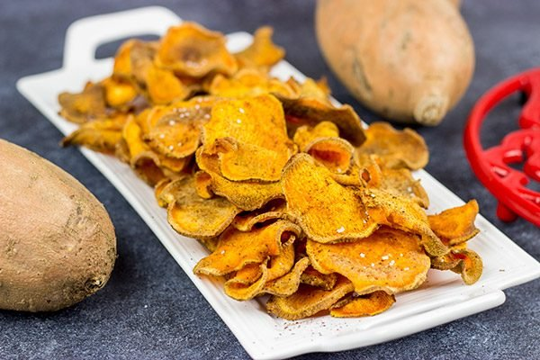 Looking for a fun snack idea? These Spicy Baked Sweet Potato Chips are sure to be a hit!