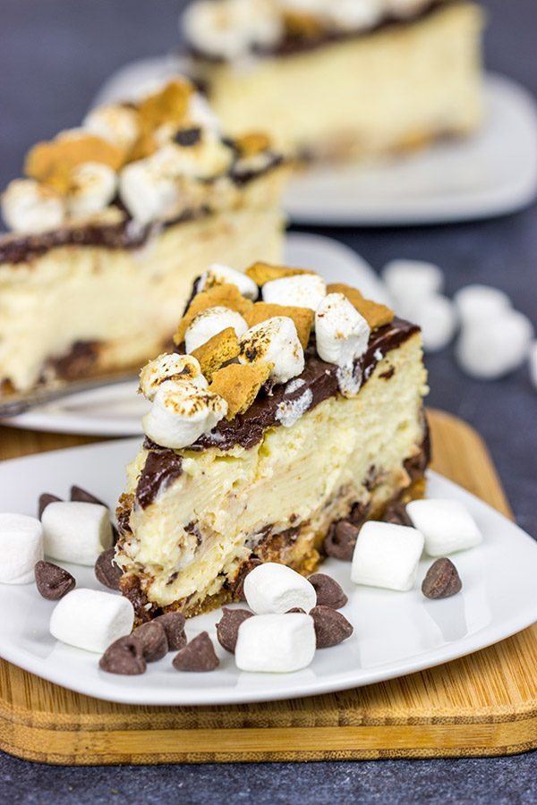 It might be chilly outside, but this S'mores Cheesecake is loaded with chocolate, marshmallow and graham crackers...and it's sure to remind you of a summer campfire!