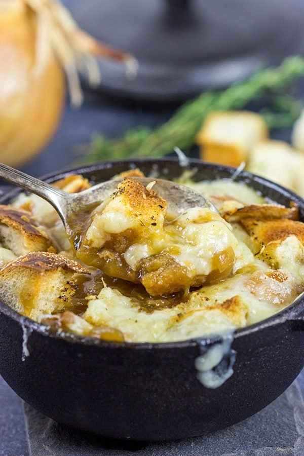 This classic French Onion Soup includes flavorful broth topped with toasted sourdough croutons and plenty of melted cheese!  It's the perfect fare for cold winter evenings!