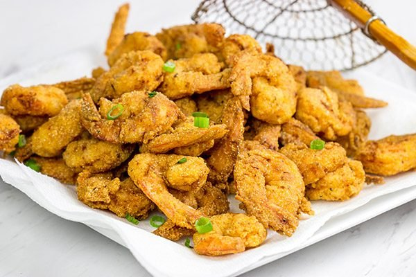 Celebrate Mardi Gras in style this year with a batch of this Cajun Fried Shrimp + Spicy Dipping Sauce!