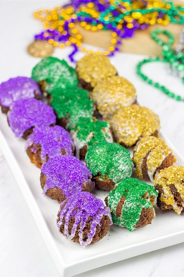 Let the good times roll with a batch of these Mardi Gras Donut Holes!