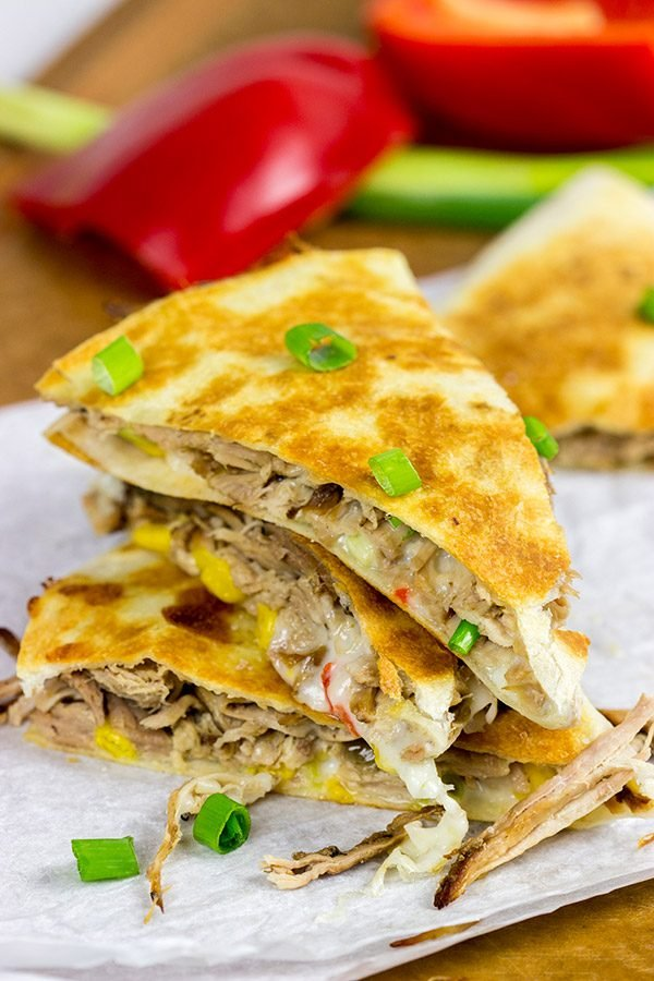 Melty cheese. Shredded carnitas. Buttery tortillas. These Slow Cooker Carnitas Quesadillas make for one heck of a tasty meal!