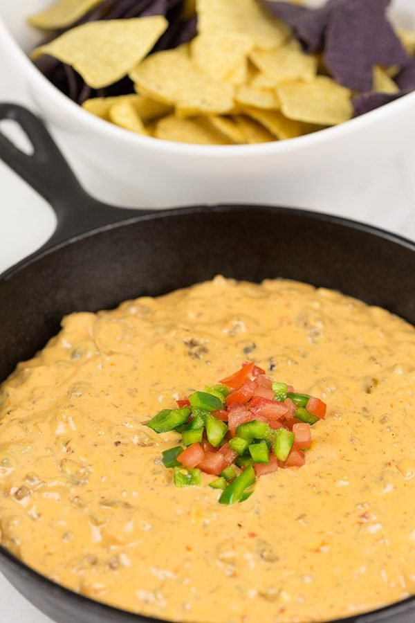 This Cheesy Skillet Queso Dip is an easy and tasty appetizer recipe, and it's perfect for watching college bowl season and playoff football games!