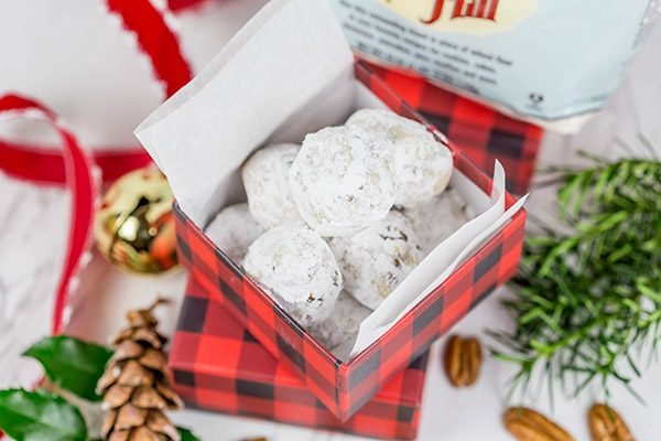 Packed with chopped pecans and rolled in powdered sugar, these Gluten Free Vanilla Pecan Snowball Cookies are one of my all-time favorite holiday cookies!