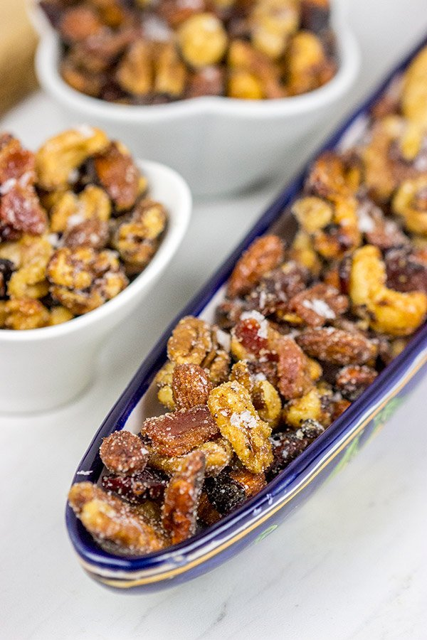 Looking for a fun and unique holiday appetizer?  These Maple Glazed Nuts with Candied Bacon are salty, sweet and delicious!