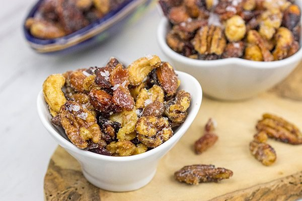 Looking for a fun and unique holiday appetizer? These Maple Glazed Mixed Nuts with Candied Bacon are salty, sweetand delicious!