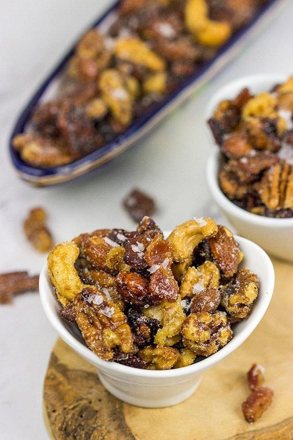 Looking for a fun and unique holiday appetizer?  These Maple Glazed Mixed Nuts with Candied Bacon are salty, sweet and delicious!