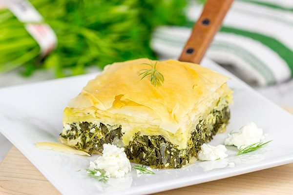 Spanakopita is a classic Greek recipe featuring layers of flaky dough stuffed with spinach and feta cheese...and it's delicious!