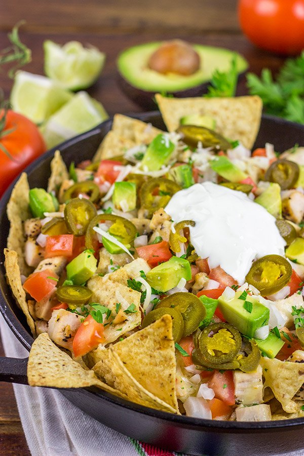 These Cast Iron Skillet Nachos are the perfect snack to serve while watching buzzer beaters in the NCAA Tourney!