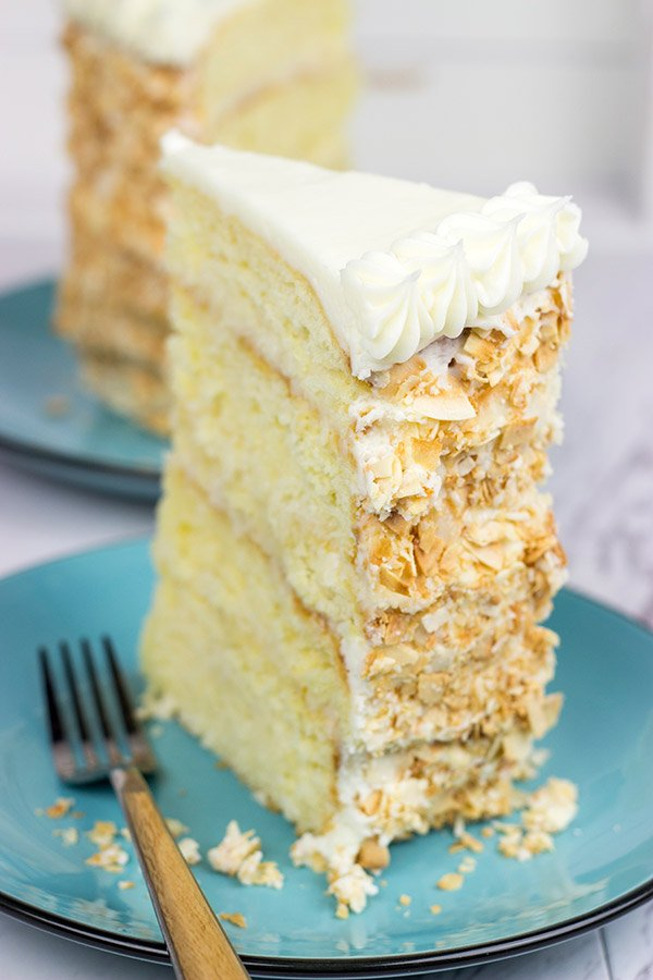 Warning: This Charleston Coconut Cake is a showstopper!  This decadent dessert features layers of coconut cake filled with coconut cream...oh, and there's a coconut cream cheese frosting, too!