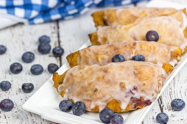 Filled with fresh blueberries and a hint of lemon zest, these Glazed Blueberry Hand Pies are the perfect dessert for warm summer days!