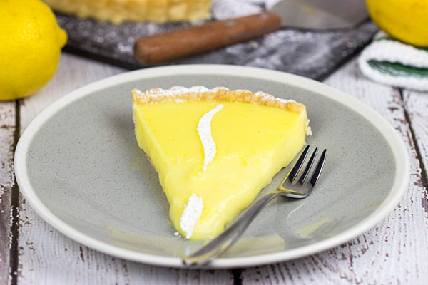 This Lemon Cream Tart is a packed with flavor, and it's the perfect dessert for a warm spring day!