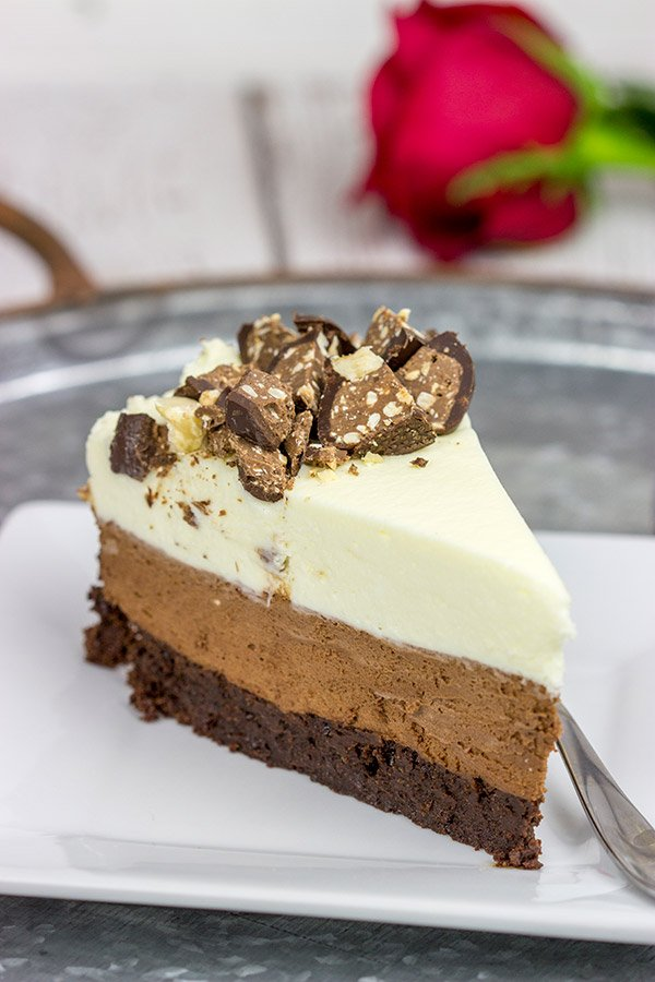 This Triple Chocolate Mousse Cake features 3 layers of chocolate, and it's topped with chopped Baci Perugina chocolate. This cake is perfect for any and all chocolate lovers in your life!