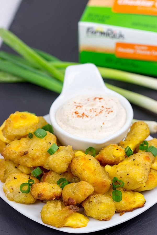 These Bacon and Cheddar Cheese Curd Bites make for a delicious appetizer...especially while watching sports!  And the smoky ranch dressing?  It's tasty enough to be a dip all by itself!