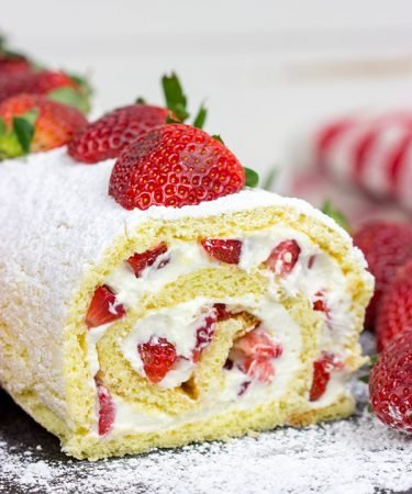 This Fresh Strawberry Cake Roll is a fun way to celebrate fresh summer strawberries! Grab a slice, sit back and enjoy!