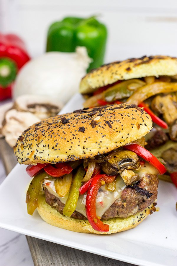 TheseGrilled Philly Burgers start with a tasty backyard burger and then get topped with BBQ-glazed onions, peppers and mushrooms!