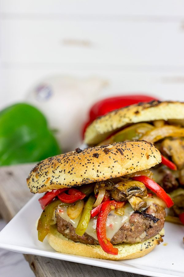 These Grilled Philly Burgers start with a tasty backyard burger and then get topped with BBQ-glazed onions, peppers and mushrooms!
