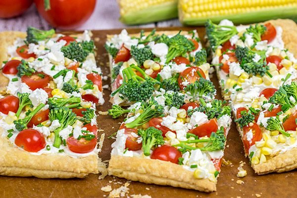 Got some extra veggies in the garden? Whip up this easy Garden Vegetable Tart! This tart is the perfect snack on a warm summer evening!