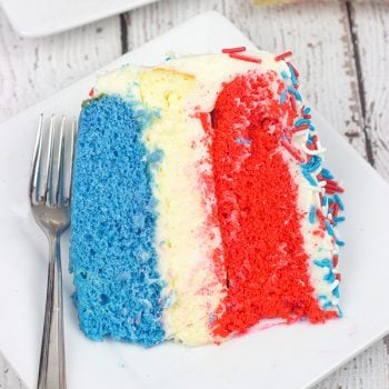Celebrate summer and the 4th of July with a slice of this Red White and Blue Cheesecake Cake!