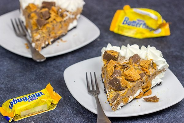 Featuring chopped Butterfinger bars both in and on top, this frozen No Bake Butterfinger Pie is a tasty dessert for a hot summer day!